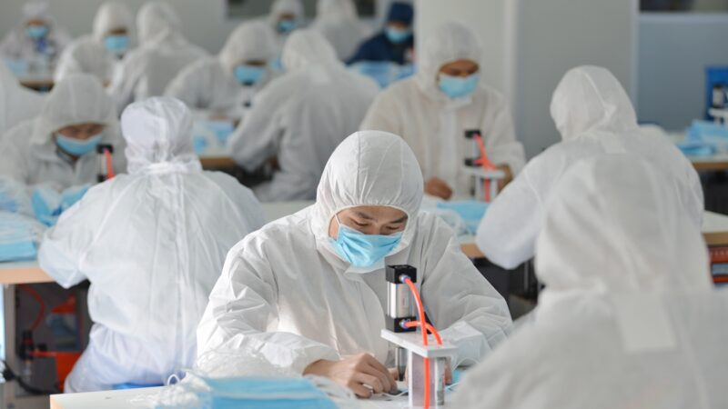 This photo taken on February 18, 2020 shows workers making face masks to satisfy increased demand during China's COVID-19 coronavirus outbreak, at a factory in Nanjing, in China's Jiangsu province. - The medical equipment factory switched surgical instruments and dental equipment production lines to a mask production line to meet the increased demand. (Photo by STR / AFP) / China OUT (Photo by STR/AFP via Getty Images)